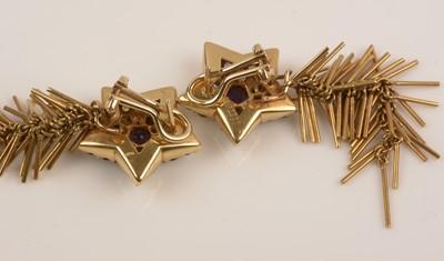 Lot 149-Glitter star shaped gemstone earrings