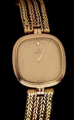 Lot 5-Omega 18ct gold cocktail watch