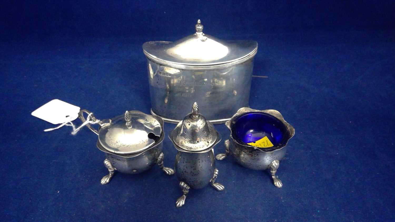 Lot 424-Silver tea caddy and condiments