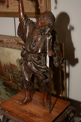 Lot 438-Japanese Meiji period figural gong and stand.