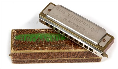 Lot 4-Melodion and Hohner harmonica.