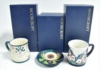 Lot 519-Moorcroft - Two mugs and a dish
