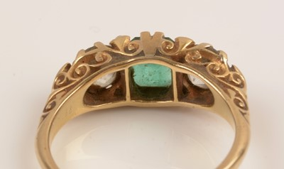 Lot 223-Emerald and diamond ring