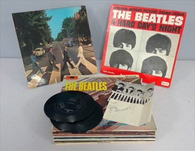 Lot 249-George Harrison autographs and LPs
