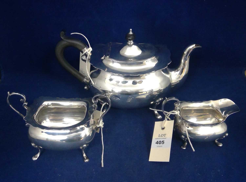 Lot 405-Silver three piece tea service