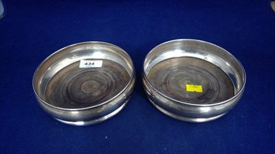 Lot 434-A pair of silver coasters