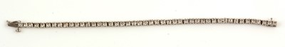 Lot 58 - Diamond tennis bracelet