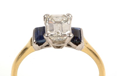 Lot 110 - A diamond and sapphire ring