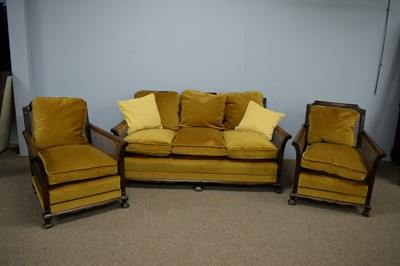 Lot 62 - Early/mid 20th C walnut Bergere three-piece suite.
