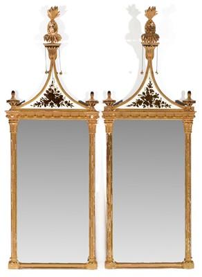 Lot 751 - A pair of modern reproduction gilt-framed pier glasses