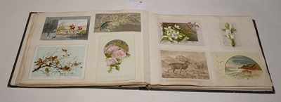 Lot 551-Two albums of Victorian postcards.