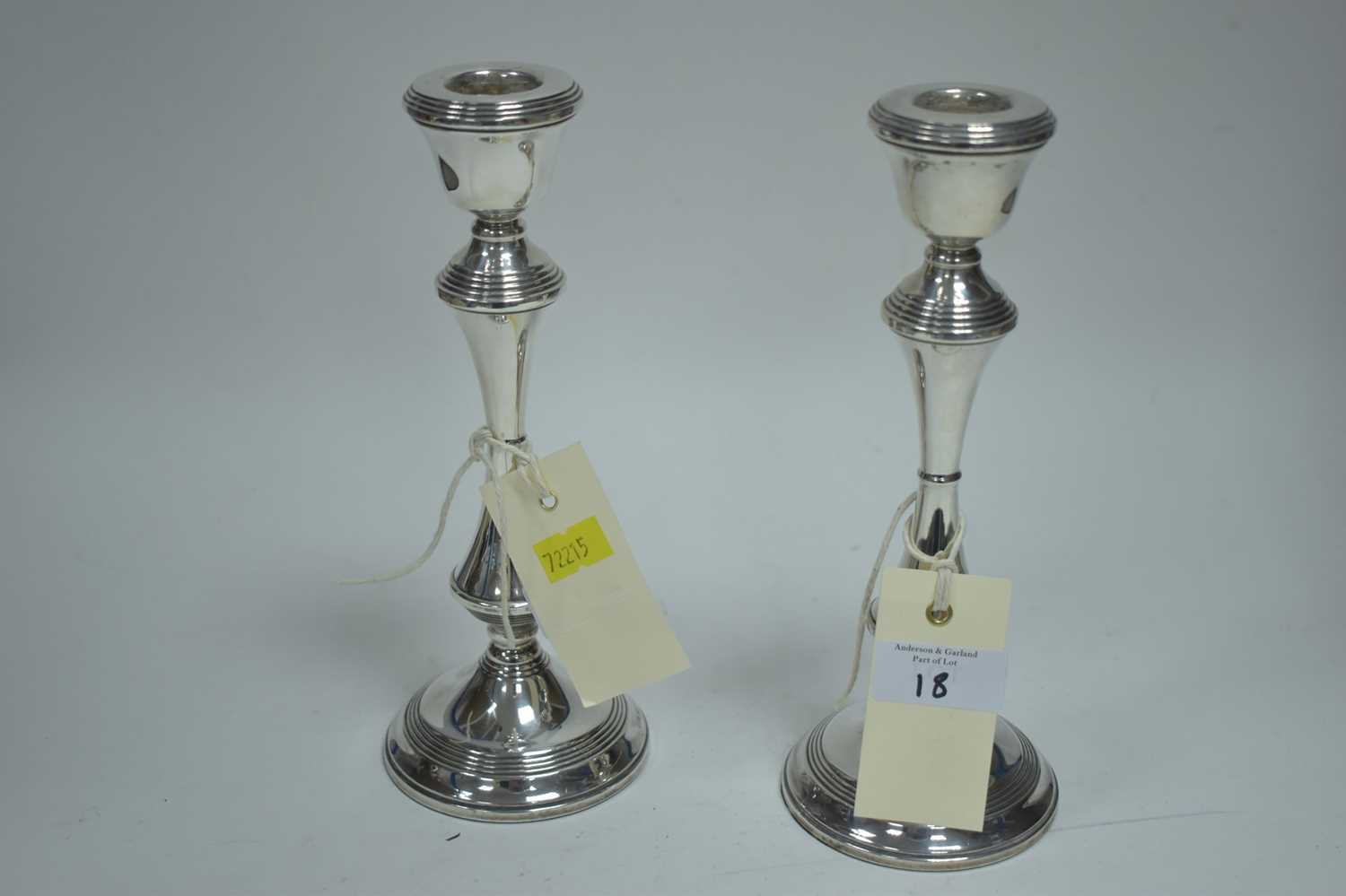 Lot 18-Pair of silver candlesticks