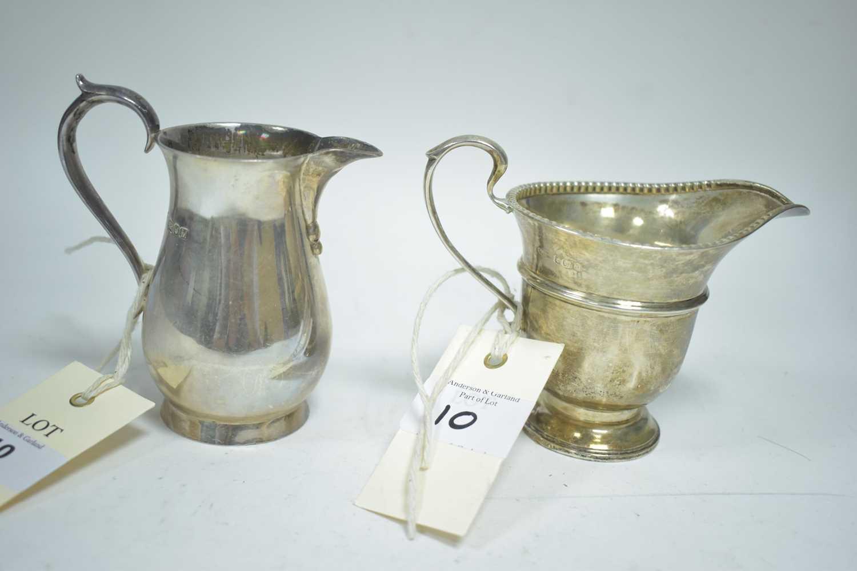 Lot 10-Two silver jugs