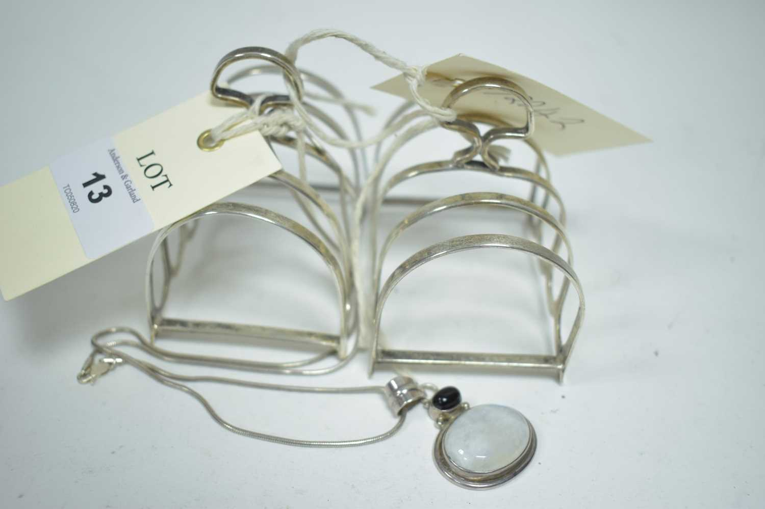 Lot 13-Pair silver toast racks and a necklace