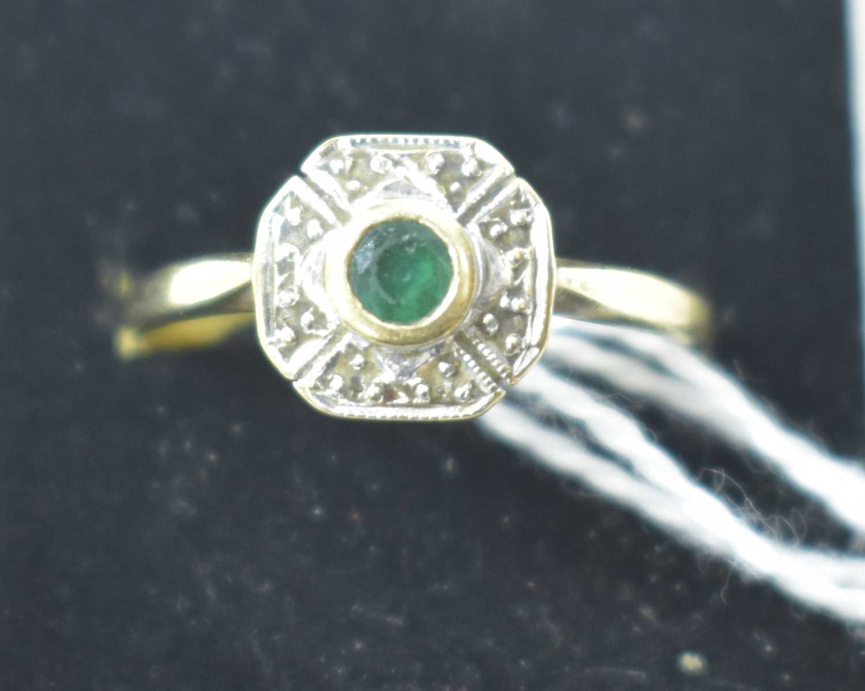 Lot 20-Emerald and diamond ring