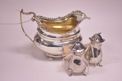 Lot 313-Silver jug and pepperettes