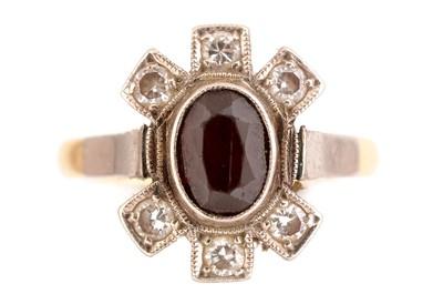Lot 40-Garnet and diamond ring