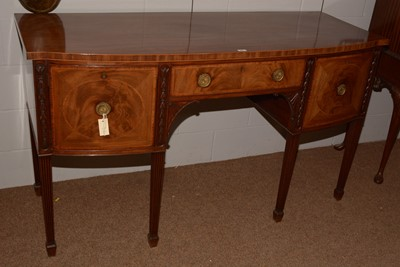 Lot 683 - A Georgian mahogany bowfront sideboard.