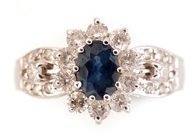 Lot 47-Sapphire and diamond cluster ring