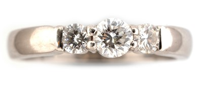 Lot 49-Three stone diamond ring