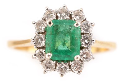 Lot 66-Emerald and diamond cluster ring