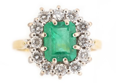 Lot 69-Emerald and diamond cluster ring