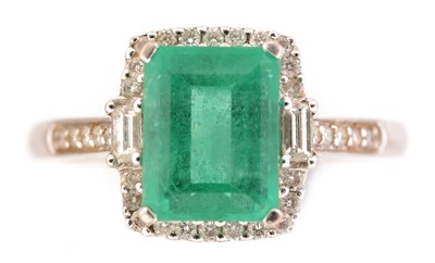 Lot 70-Emerald and diamond cluster ring