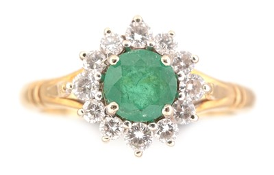 Lot 77-Emerald and diamond cluster ring
