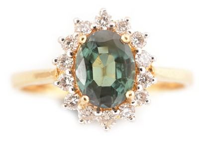 Lot 80-Alexandrite and diamond cluster ring