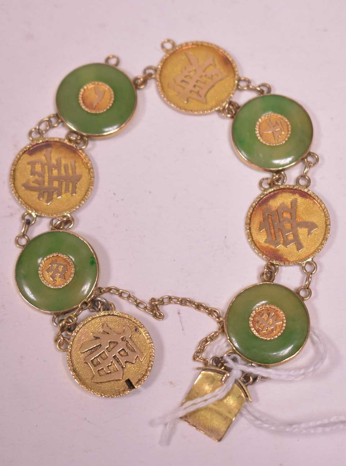 Lot 4-Chinese jade and gold bracelet