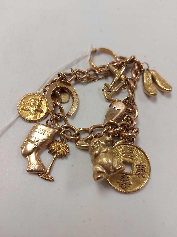 Lot 5-Gold charm bracelet