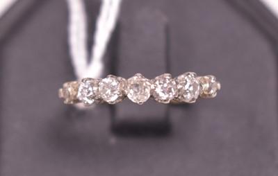 Lot 9-A seven stone diamond ring