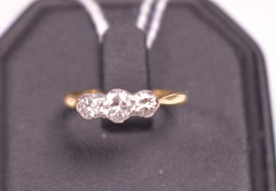 Lot 10-Three stone diamond ring