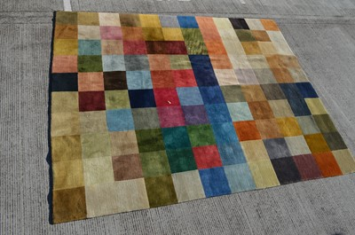 Lot 572 - A modern checkerboard carpet woven in colours,...