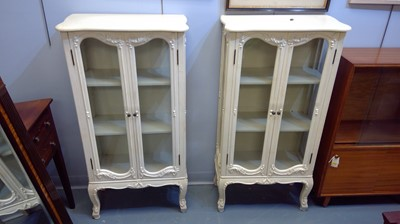 Lot 644 - A pair of 20th Century cream painted display...
