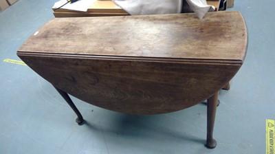 Lot 717 - A 19th Century mahogany drop leaf table