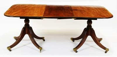 Lot 425 - A late 19th Century mahogany twin pedestal dining table.