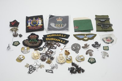 Lot 958-Collection of military buttons, cap badges, shoulder titles.