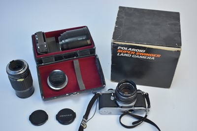 Lot 800-A Pentax camera; lenses and accessories.