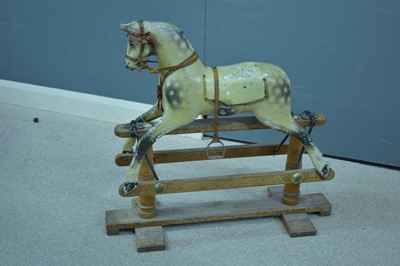 Lot 1102-Vintage carved wood and painted rocking horse.