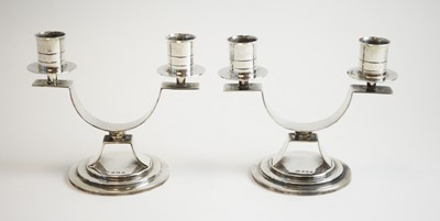 Lot 104 - A pair of silver twin branch candelabra