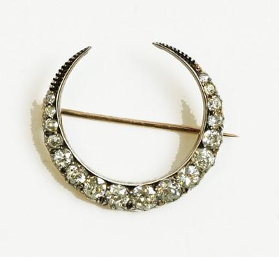 Lot 41 - Victorian diamond crescent shaped brooch