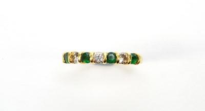 Lot 11 - Emerald and diamond ring