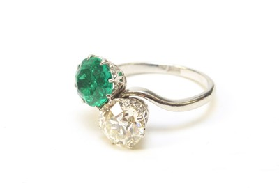 Lot 8 - A Colombian emerald and diamond ring
