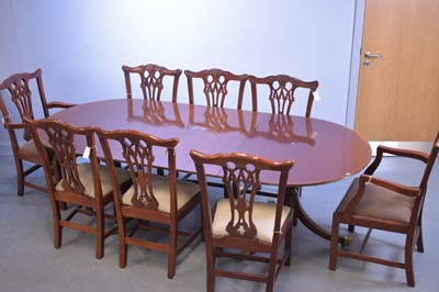 Lot 537 - Reproduction mahogany dining table and eight chairs