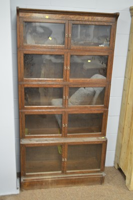 Lot 548 - Early 20th C oak stacking bookcase.