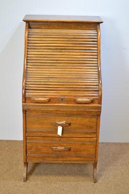 Lot 488 - Early 20th C narrow oak roll-top desk.