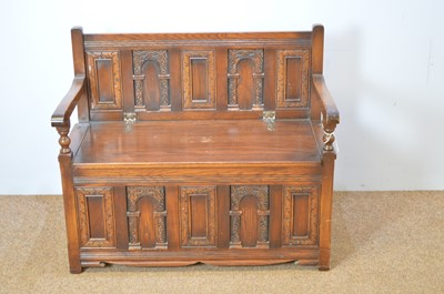 Lot 476 - Old Charm oak hall seat in 17th C style.
