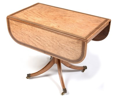 Lot 894 - A late George III satinwood and banded drop-leaf table.