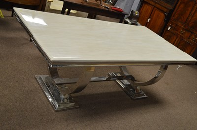 Lot 577 - A modern chrome dining table.